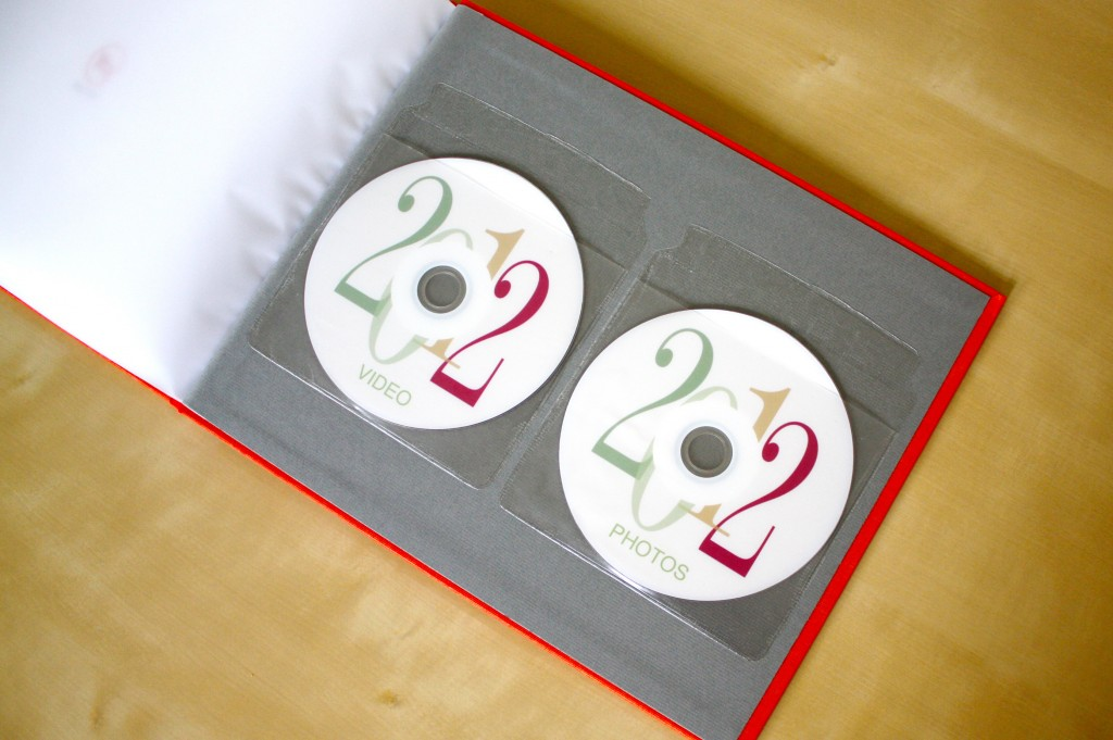 Put video and photo back up DVDs in plastic sleeves in the back of yearly photo book