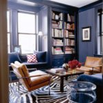 dark blue library designed by Todd Alexander Romano