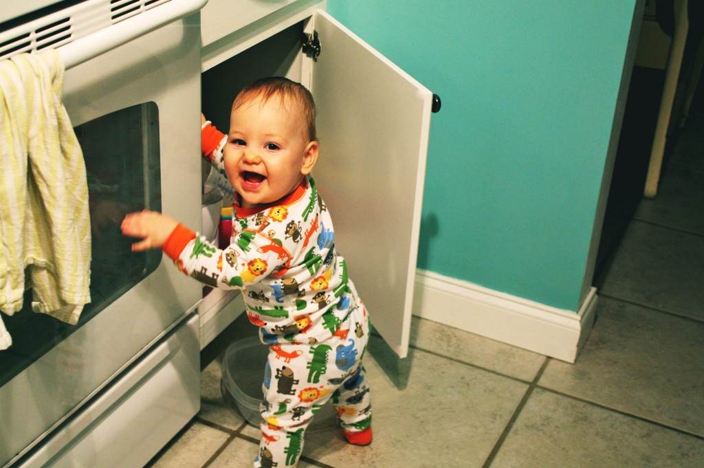 baby getting in cabinets