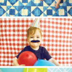 Tablecloths and sheets as photo backdrops for kids