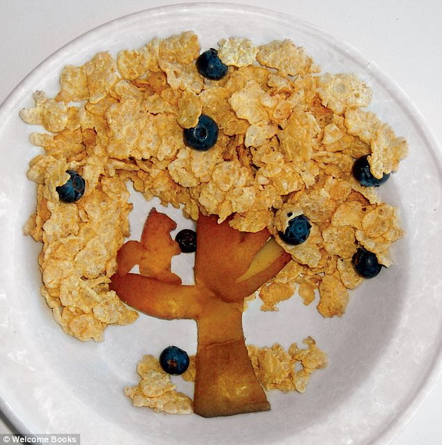 """Funny Food: 365 Fun, Healthy, Silly, Creative Breakfasts"" by Bill and Claire Wurtzel features this cereal tree of apple, cornflakes, and blueberries. I don't think I have the apple-peeling skills for the squirrel, but I bet it'd be fun to let the child pour milk on the tree."