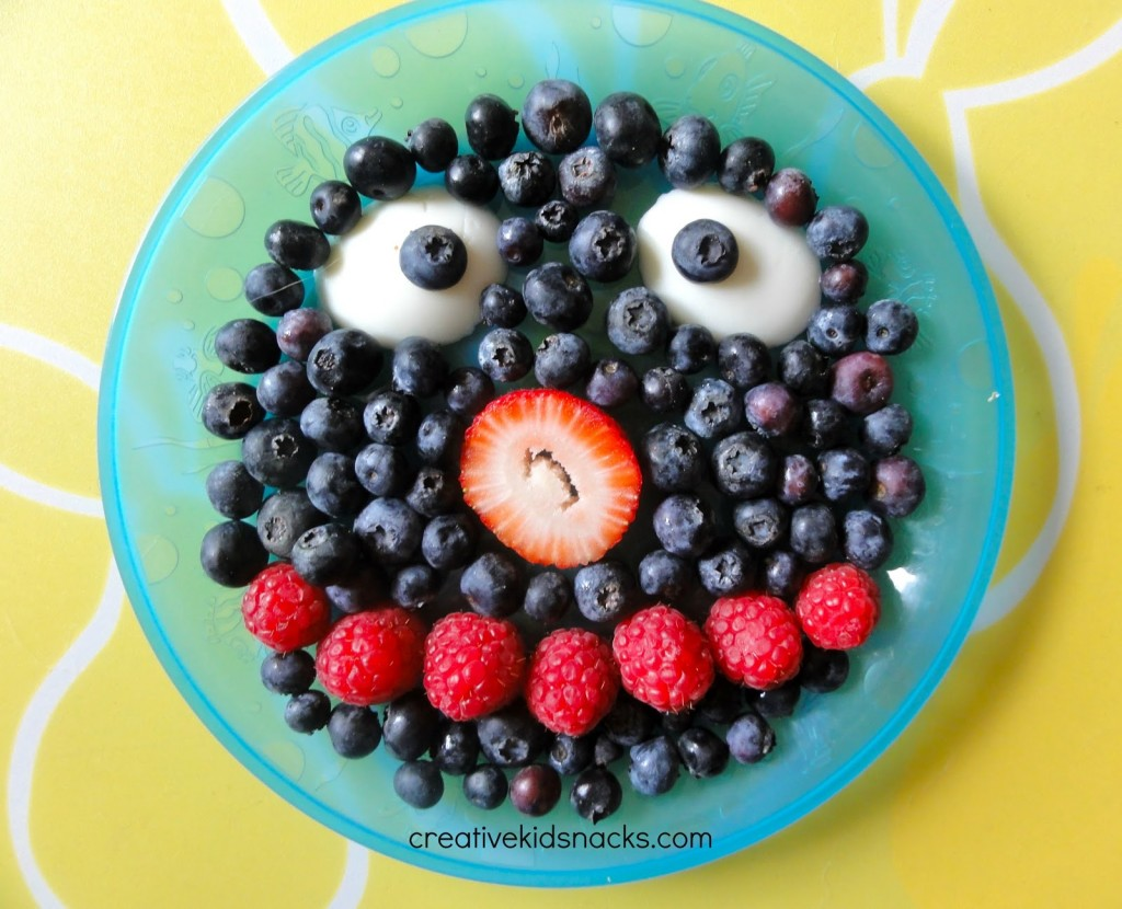 Creative Kid Snacks has some clever ideas. Here, Grover has eyes of yogurt, a face of blueberries, raspberries for his mouth, and strawberry for a nose.