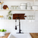 open kitchen shelving with subway tile and butcher block counter