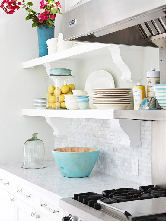 open kitchen shelving with turquoise pops