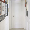 Mismatching photo hallway with chair rail and moulding