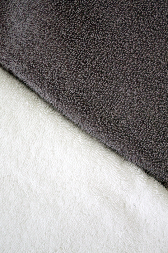 Use crisp clean white full size towels and charcoal for hand towels and wash cloths to hide makeup stains