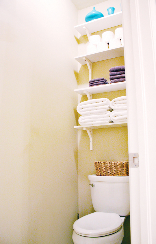 Bathroom shelves above toliet create extra storage