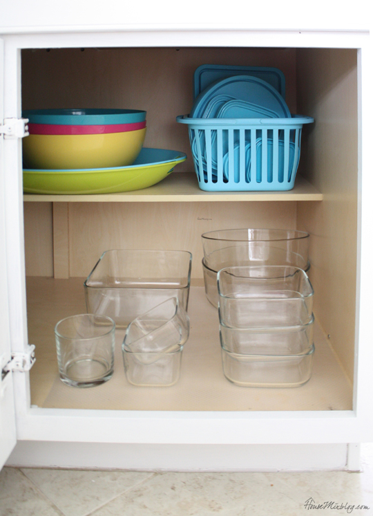 Organized glass tupperware cabinet