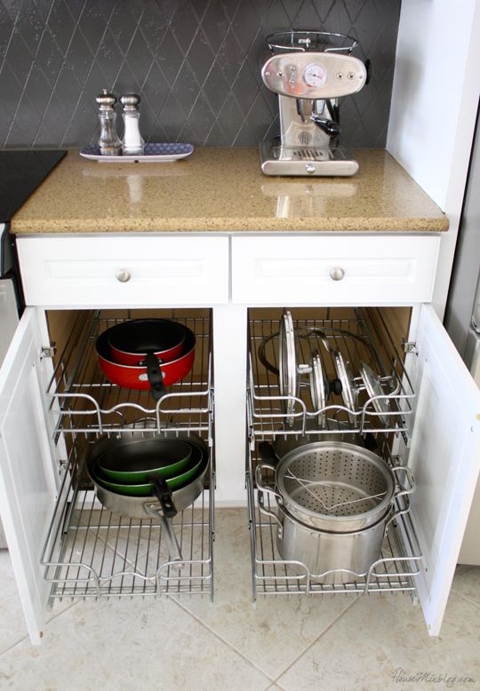 organized pots and pans cabinets with lids