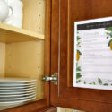 Printable daily cleaning schedule inside kitchen cabinet