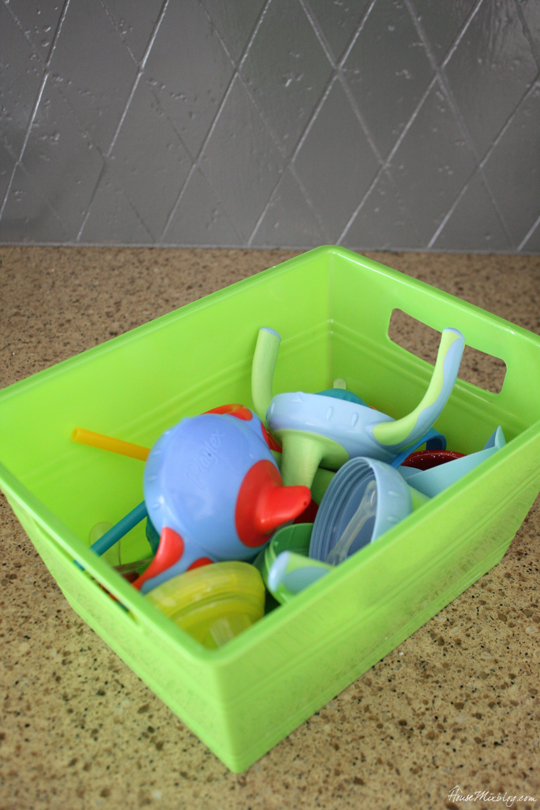 Use a container for all the kid sippy cup pieces