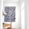 Use a rug as art on a big blank wall