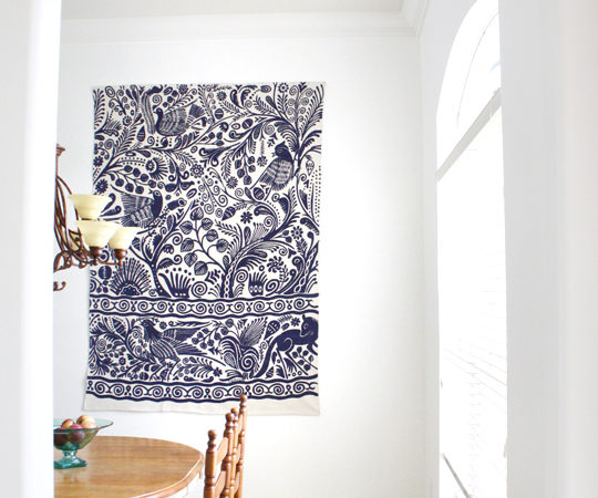 Use a rug as art on a big blank wall