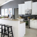 Kitchen with white cabinets and Kendall Charcoal gray walls and backsplash