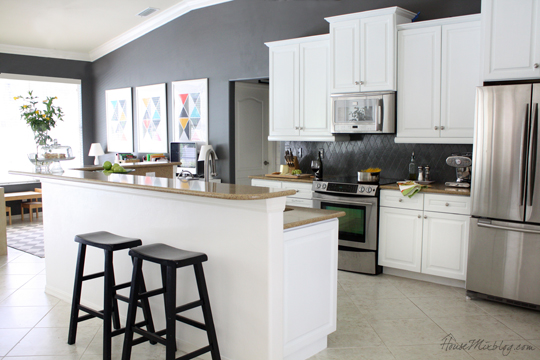 Kitchen with white cabinets and Kendall Charcoal gray walls and