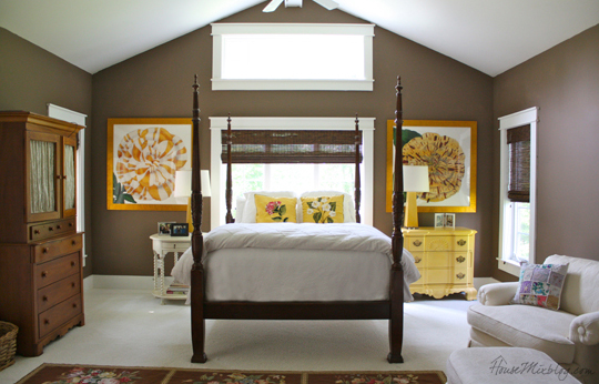 Chocolate brown walls in master bedroom with cream and yellow accents