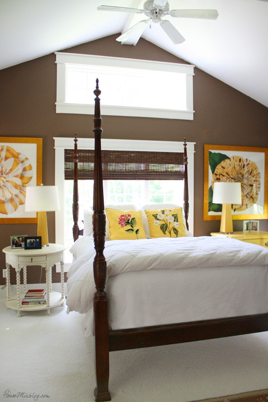 Dark brown chocolate walls in master bedroom with yellow accents