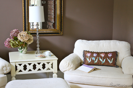Dark brown walls with cream furniture