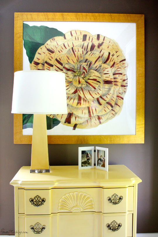 Large scale yellow flower art in gold frame