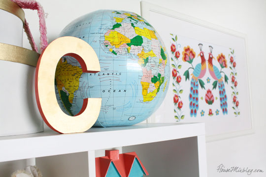 Bright girls nursery with white walls