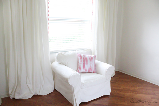 Buy two sets of curtains for an average-size window to make a statement