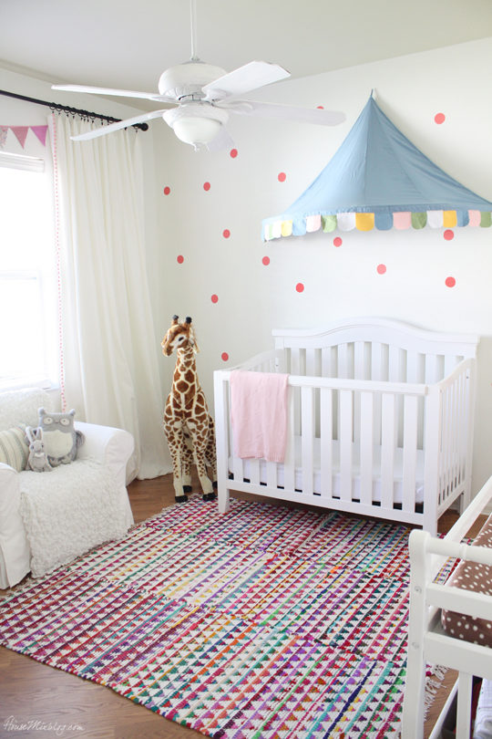 Coral and blue girls nursery with white walls