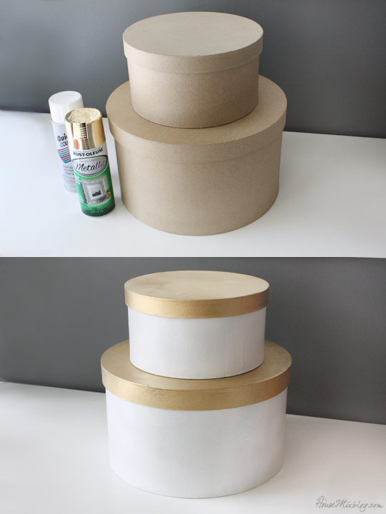 Paint inexpensive paper mache boxes gold and white
