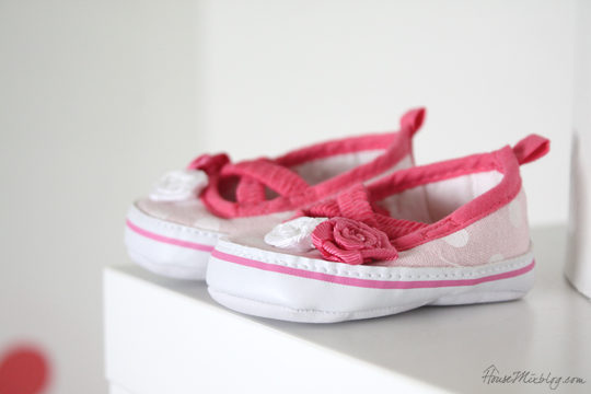 Pink and white newborn shoes