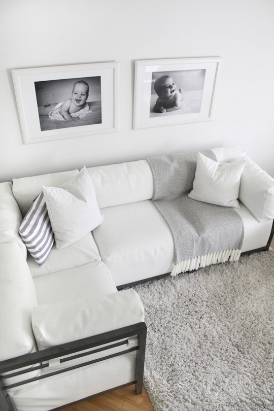 White modern couch with black and white photos