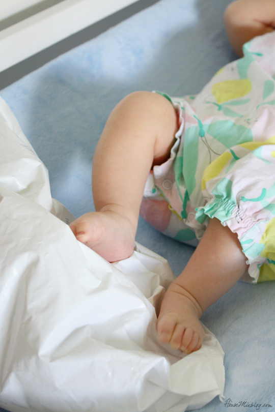 newborns love the crinkly sound of kicking an empty wipes bag — and it's good exercise too!