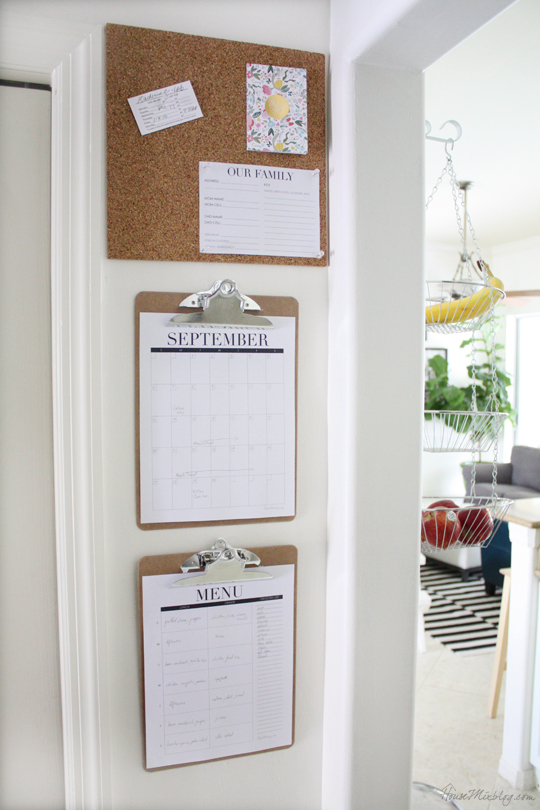 I put up a mini command center on a corner wall to help with scheduling and menus. Get the printables here.