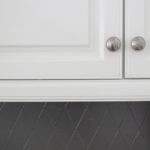 Painted kitchen cabinets and tile backsplash — a year later