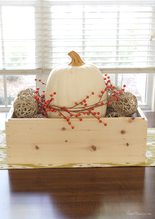 fall centerpice in a wooden box for a large table