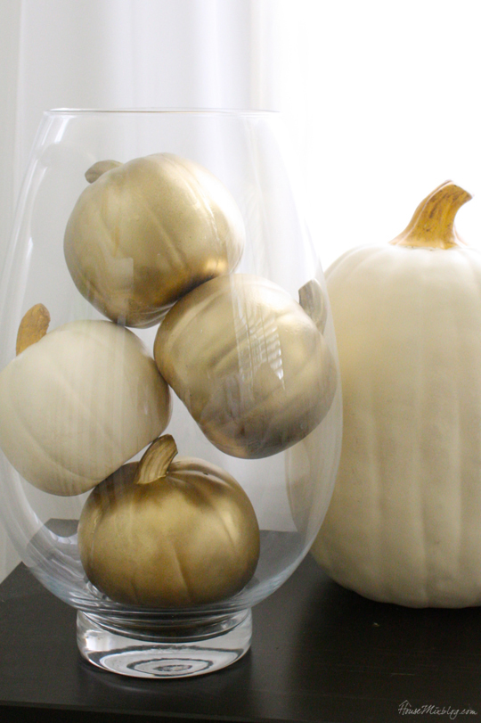 gold spray painted pumpkins in vase for easy fall decor