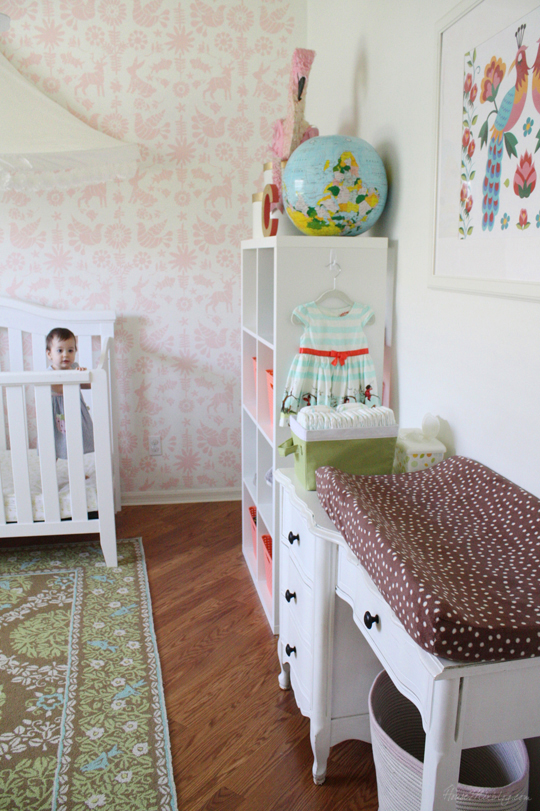 Colorful girls room with pom pom canopy and stenciled wall