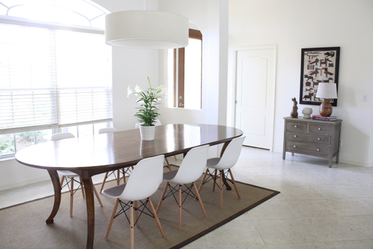 Dining room with white walls modern chairs and oversized ...