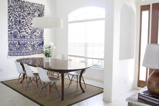 White Dining Room With Bold Blue Rug As Art