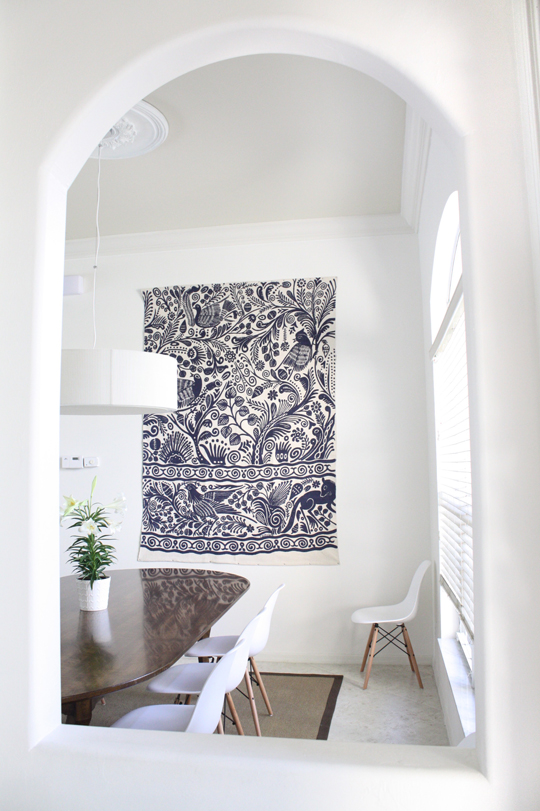 White dining room with rug as art
