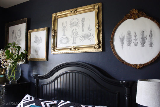Gold frame gallery wall on navy blue walls