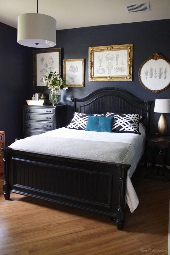 Navy blue (Hale Navy) bedroom with nautical diy art in gold frames