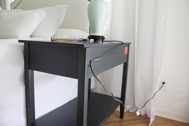tacks-behind-nightstand-to-hide-lamp-cord