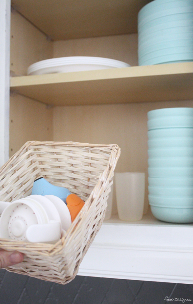 Keep a basket for sippy cup lids