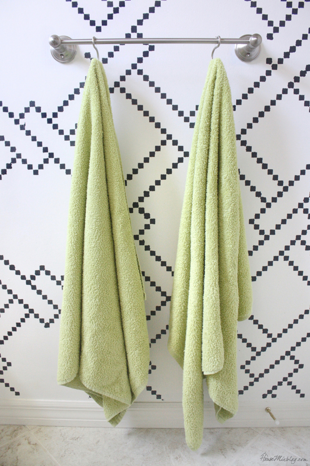 Organizing the kids bathroom. Use hooks for towels so kids can hang up their own towels.