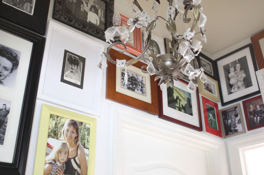 family photo gallery wall in hallway with both old and new photos