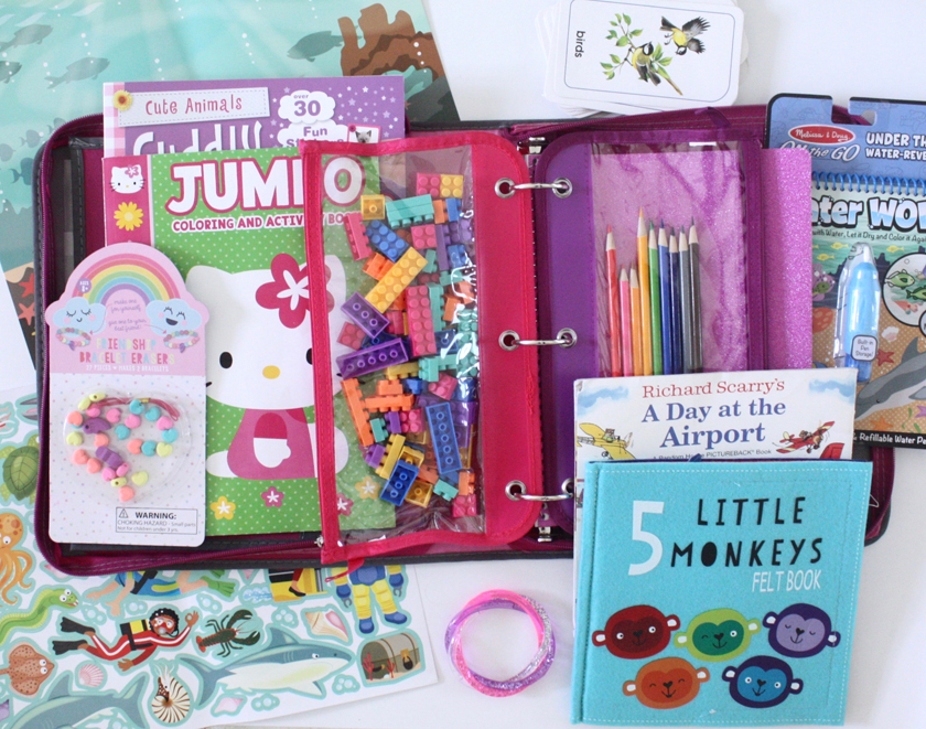 Girls travel activity binder with lots of fun games and things to do