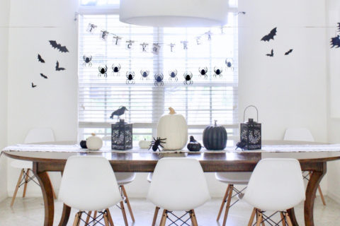 Black and white Halloween table setting and decorations
