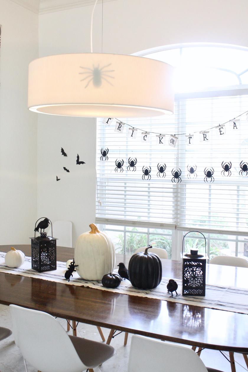 Black and white halloween tablescape - stick a spider inside a lampshade for a spooky effect