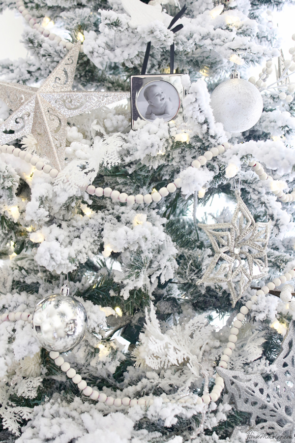 Flocked all white tree with silver and white ornaments