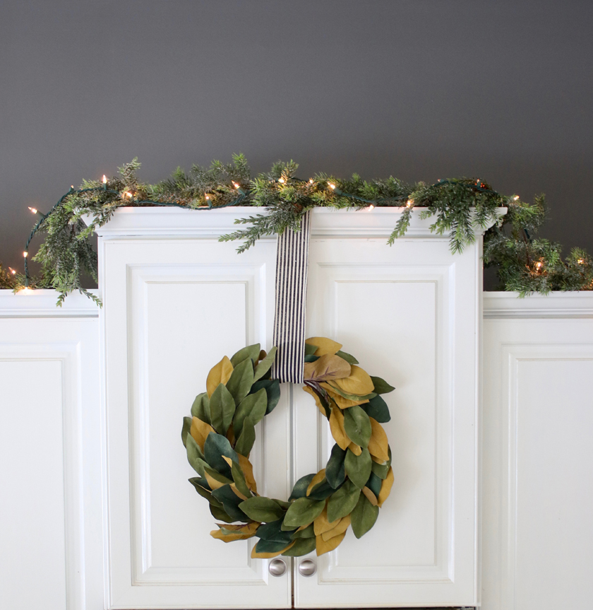 Garland twinkle lights and wreath in kitchen for Christmas
