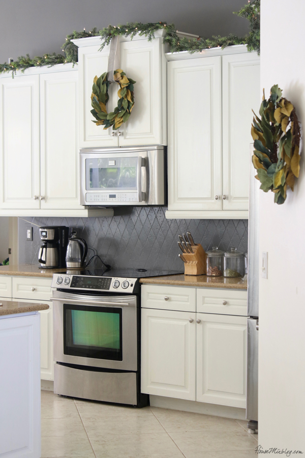 White kitchen with green garland and wreath Christmas decor